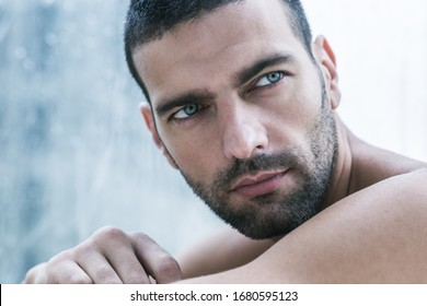 Sexy closeup portrait of topless handsome male model with beautiful eyes.
