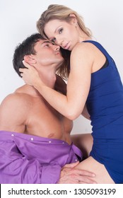 The sexy couple is aroused by one another.