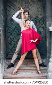 Sexy couple of dancers posing near old wall outdoors, newlywed couple on honeymoon dancing outdoors, elegant motions and poses by man and woman