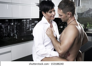 Sexy couple in kitchen