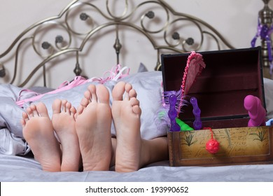 sexy couple lying in bed. use sex toys.