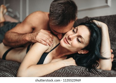 Sexy couple makes love in bed, erotica