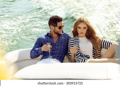 Sexy couple on the luxury boat