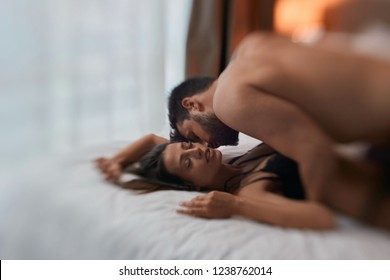 Sexy couple in passion - Loving couple in bed having sex.