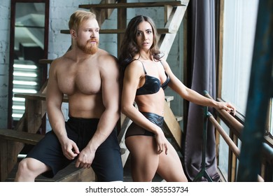 Sexy couple. Portrait athletic man and woman.