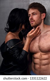 Sexy couple portrait. Man with nude torso touching his sensual beautiful girlfriend neck with much emotion. Closeup.