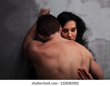 Sexy couple portrait. Man sexual toching and kissing his sensual beautiful girlfriend neck with much emotion. Closeup portrait