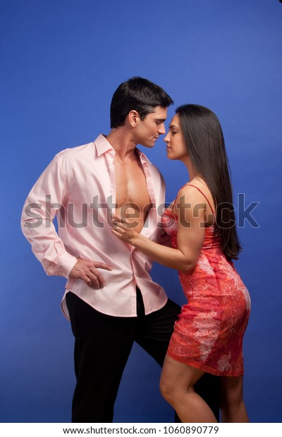 the sexy couple poses for a loving embrace together.