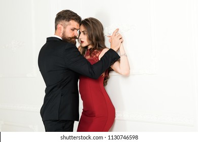 Sexy couple, sensual couple, sexual people. Love, relations, dominating. Dominating in the foreplay sexual game. Woman dominates the man, sexy games, obeys man. Pretty young woman and man with beard.