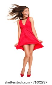 Sexy crazy woman excited and screaming with wind in the hair. Beautiful happy asian model standing  playful in red dress isolated on white background.