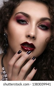 Sexy curly Beauty Girl with purple Lips. Provocative Make up. Luxury Woman with blue Eyes. Fashion. Gorgeous Woman Face. Long curly Hair
