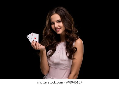 Sexy curly hair brunette posing with chips in her hands, poker concept black background
