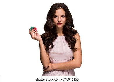 Sexy curly hair brunette posing with chips in her hands, poker concept isolation on white background