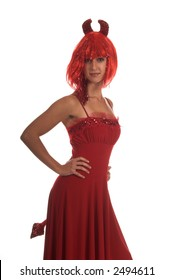 Sexy devil in a red dress, replete with horns and tail