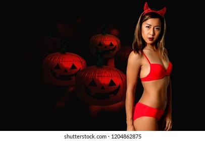 sexy devil woman in red bikini and halloween