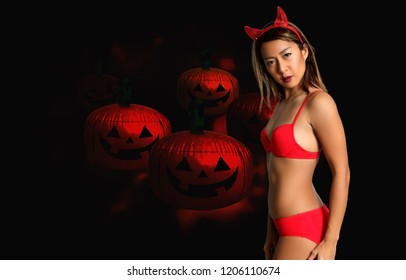 sexy devil woman in red bikini and halloween