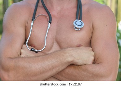 Sexy Doctor - Fit male with stethoscope showing off muscles