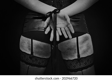 sexy dominant / submisive  woman in latex lingerie and hands in chains bdsm