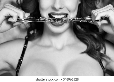 Sexy dominatrix bite handcuffs, black and white, bdsm