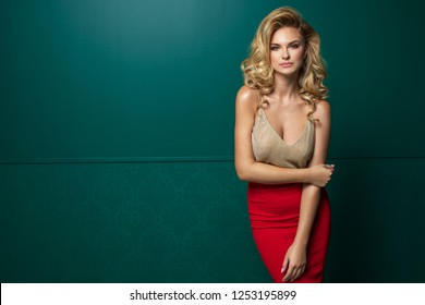 Sexy elegance blonde woman over trendy green background