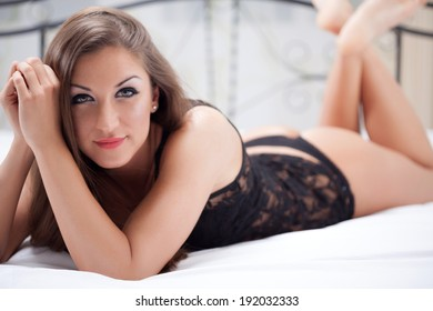 sexy elegant woman lying on the bed