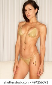 Sexy ethnic gold bikini fitness woman