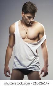 Sexy fashion portrait of a hot male model