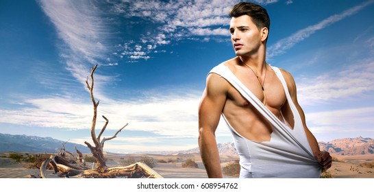 Sexy fashion portrait of a hot male model in Death Valley National Park