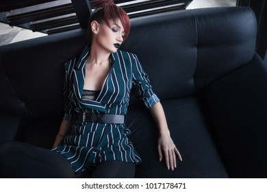 sexy fashion woman with red hair posing