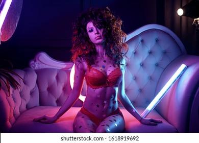 sexy fashion young woman in erotic dancing striptease in nightclub. Beautiful nude body of sensuality elegant lady. Nude sexy woman in black underwear. Sexy female. Erotic portrait girl