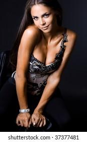 Sexy fashionable woman on black