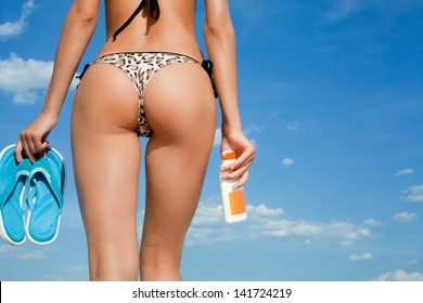 Sexy female back on the beach