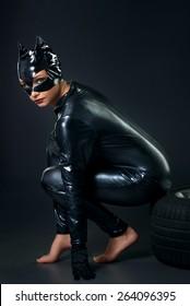 Sexy female in black catwoman costume