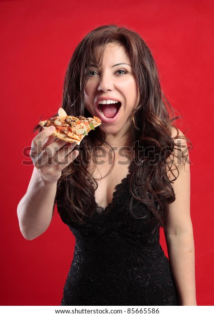 Sexy female eating a slice of delicious pizza