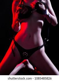 Sexy female fetish-wear. Sensual girl. BDSM. Fetish lingerie. Striptease in nightclub. Beautiful nude body of sensual. Sexy woman in erotic fetish wear. Naked girl. Nude sexy woman in black underwear.