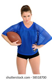 Sexy female football player holding ball, scowling in blue mesh jersey