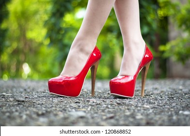 Sexy female  high heeled red shoes  on the way