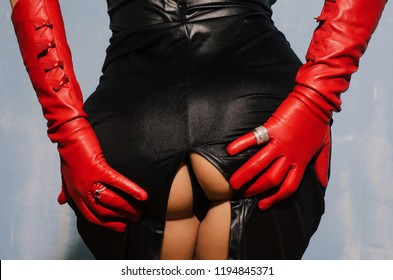 Sexy female holding her butt, sexy ass in black spandex dress.