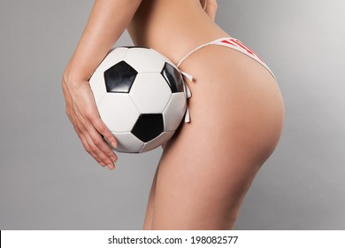 sexy female holding soccer ball