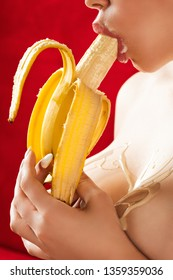 Sexy female mouth and bust. Lady eats banana, blowjob concept