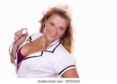 Sexy female nurse smiling and holding her stethoscope. Her bra is showing.