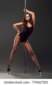 Sexy female pole dancer with stage look posing for fashion magazine cover