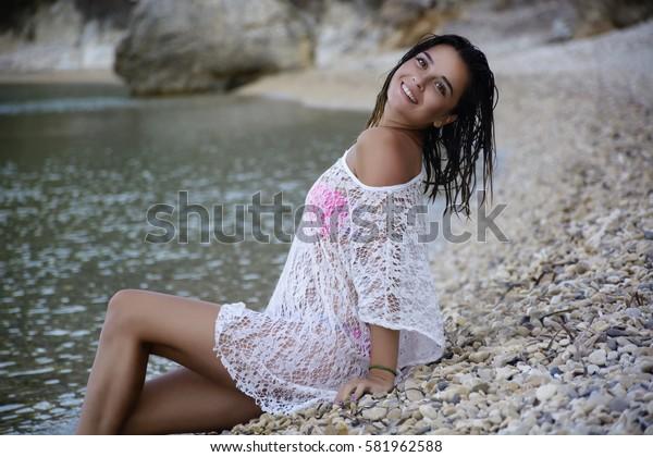 Sexy female posing on the seashore