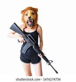 Sexy female soldier or terrorist with lion mask holding M16 gun or rifle weapon isolated on white background with copy space for text. Halloween fancy dress, murderer, gray market industry concept.