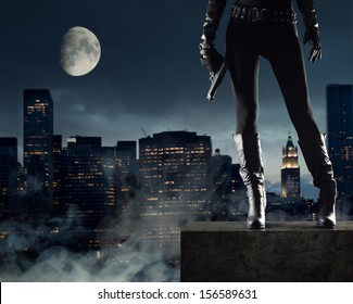 Sexy Female thief with gun, new york on background