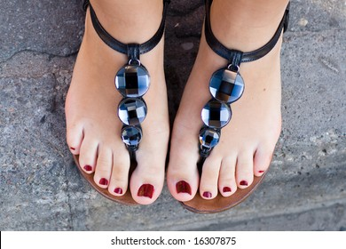 sexy feminine feet with sandals