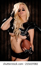 Sexy Fierce young woman Football Player