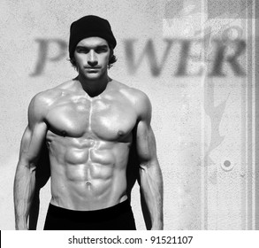 Sexy fine art black and white portrait of a very muscular shirtless male model