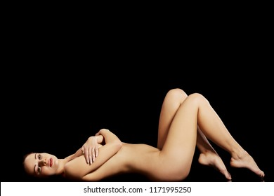 Sexy fit naked woman with healthy clean skin , isolated on black background
