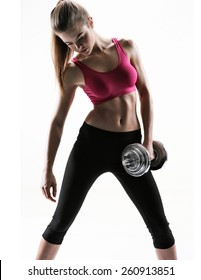 Sexy and fit woman lifting hand weights / photo set of sporty muscular female brunette girl wearing sports clothes working out with dumbbell over white background